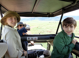 Isabelle & Max watch lions in the crater.