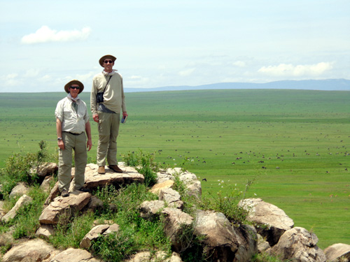 The great landscapes of Africa are incapable of being shown on a photo.  The dots behind Mort and Jared are some of the half million animals then on the veld.