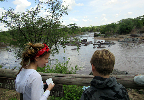 Isabella & Magnus watch hippos in the Grumeti at Retima.