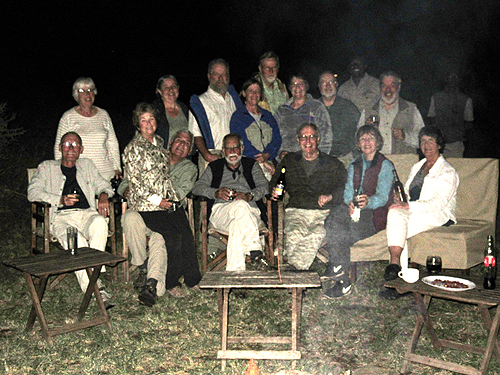 Our last camp fire: Bill Vogt, Caroline Barrett, Connie & Harvey Fox, Cindy & Jim Pease, Steve Farrand, Judy & Bill Melville, Kathy & Dave Littlejohn, Lynn Vogt, Brian Barrett & Judith Fasani.  As usual, I'm holding the Tusker.