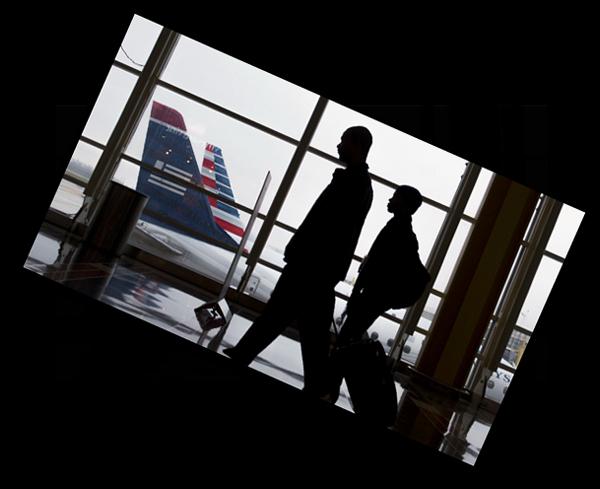 Passengers walk through aterminal at Reagan National Airport in Arlington, Va.,last mont